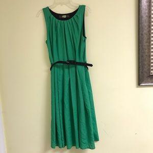 Flowy green dress with black belt